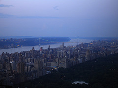 Dusk Settles Over New York, And In The Distance Lights Turn On  The George Washington Bridge.