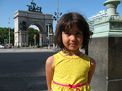 Young Girl Posing In Front Of Grand Army Plaza In Brooklyn, Near Fifth Avenue.