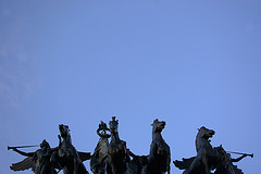 Statues At The Top Of The Soldiers &amp; Sailors Arch At Grand Army Plaza Against A Radiant Blue Sky