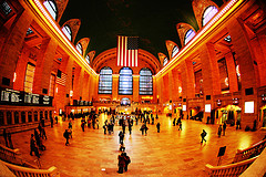Commuters Cross The Main Concourse Of Grand Central Terminal Underneath The Flag Hung After 9-11