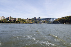 Churning Waters Of Spuyten Duyvil Creek, With The Henry Hudson Bridge In The Background