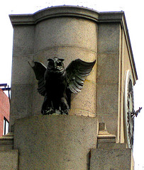 An Owl Statue Keeps Guard Over The Huge Clock In Herald Square