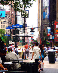 Shoppers Stroll The Streets Of Herald Square On A Hot Summer Day In The City