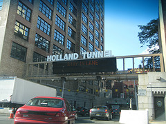 Cars Drive Under The Hudson River Through The Holland Tunnel