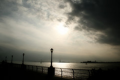 View Of The Statue Of Liberty Across The Hudson River On A Cloudy Day