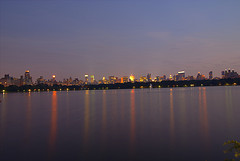 A Vivid After Sunset Picture Of The New York Skyline Over The Jacqueline Kennedy Onassis Reservoir