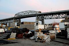 Trash And Construction Mar The Skyline Of The Kosciuszko Bridge.