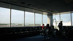 Inside  LaGuardia Airport Looking Out Onto The Busy Runway
