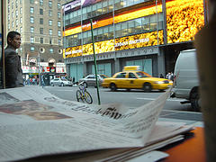 A Yellow Cab Races Past The Yellow Ad Decorating The Lehman Brothers Building