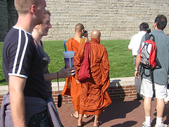 A Normal Sight Of Monks In New York Captured On Liberty Island During The Summer