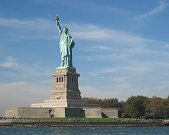 The Statue Of  Liberty On Liberty Island Welcomes Immigrants Coming To America