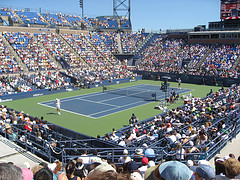 A Heated Tennis Match At The Louis Armstrong Stadium.