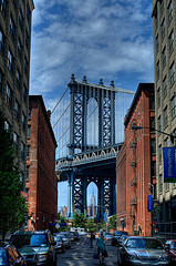 Stunning View Of The Manhattan Bridge Framing The Empire State Building.