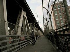 Man Is Riding His Bicycle Happily On Manhattan Bridge