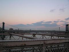 Sunset Behind Manhattan Bridge Connects Brooklyn To Manhattan, Built 1909, Steel Cable Construction