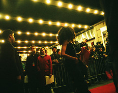 A Finely Dressed Woman Walks The Red Carpet Into An Event At The Manhattan Center