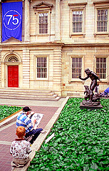 Visitors Sit By Plants In The Metropolitan Museum Of Art