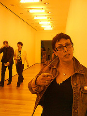Funny Faced Lady Points Her Finger As She's Walking Through The Museum Of Modern Art