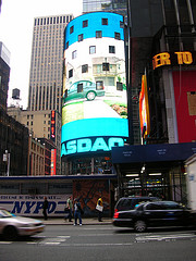 Daylight Photo Of The Nassau Sign Above A Busy Street In Times Square