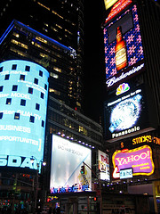 Electric Billboards And Nassau Loom Over Times Square At Night