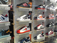 Store Display Of Adidas Basketball Shoes With Nabs Team Colors And Logos