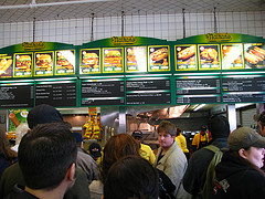 A Crowd Waits There Turn For World Renowned Hot Dogs At Nathan's Famous In New York City