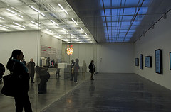 People Browsing An Art Exhibition At The New Museum Of Contemporary Art