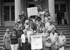 Elderly Group With Welcome Sign On The Steps Of New York City Hall