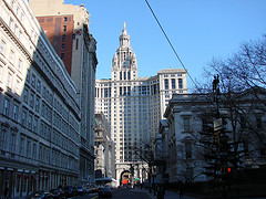 New York City Hall, With The Municipal Building Rising In The Background.