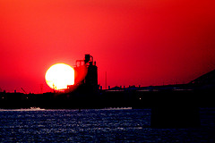 A Vibrant Red Sunset On The New York Harbor Which Are Typical Of Nyc