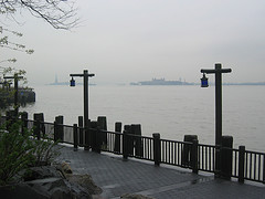 A Nice Foggy Day Over The New York Harbor With The Statue Of Liberty In The Distance