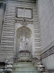 A Beautiful Statue Graces The Entrance To The New York Public Library.