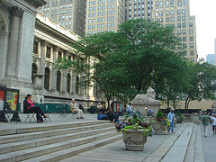 People Enjoying The View From The Steps Of The New York Public Library