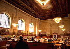 Shelves Of Books In A Cavernous Room At The New York Public Library
