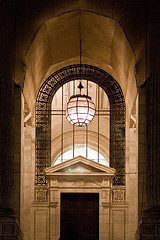 A Classic Shot Of The Lighted Entrance Way Of The New York Public Library