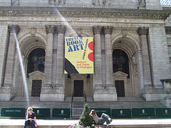 People Relax Outside The Columned New York Public Library