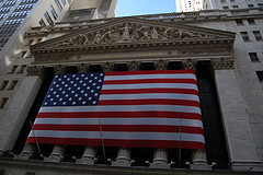 Shot Of The American Flag Draped On The Facade Of The Nyse Building.