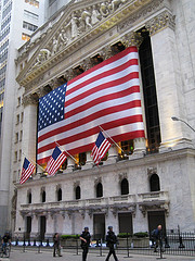 Flags Waving In The Wind As Police Walk By The New York Stock Exchange