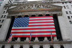 The Flag Of The United States Of America Hangs At The New York Stock Exchange