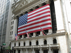 Facade Of The New York Stock Exchange With The American Flag