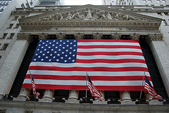 Flags On The Outside Of The New York Stock Exchange Located On Wall Street.