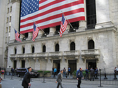 The New York Stock Exchange Adorned With The American Flag In The Heart Of Lower Manhattan