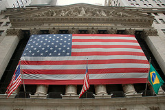 Looking Up At An Intimidating Flag And Columns At The New York Stock Exchange