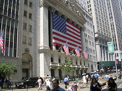 The American Flag Is Prominently Displayed On The Face Of The New York Stock Exchange