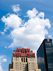 Just Look At Those Fluffy White Clouds Behind The New Yorker Hotel Sign