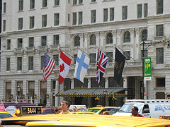 Flags Fly Above The Entrance Of The Plaza Hotel