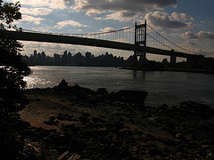In The Fading Light Of The Day, The Triborough Bridge Is Pictured With New York Buildings In The Background.