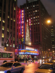 The Bright Lights Of Radio City Music Hall Shine In The Night Sky