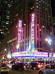 Bustle Of Cars Line Up In Front Of Radio City Music Hall