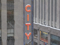 A Close-up Of The Radio City Music Hall Sign As The Snow Gently Falls.
